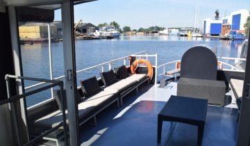 Achterdek van boot4 varende feestlocatie in Amsterdam.